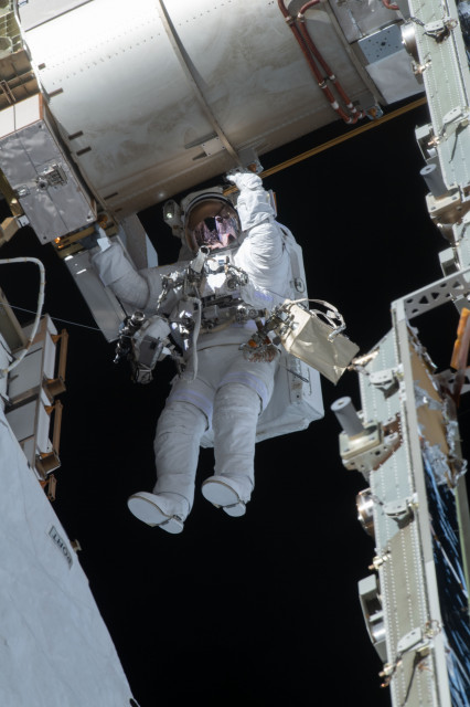NASA Astronaut Victor Glover Works to Upgrade the Station