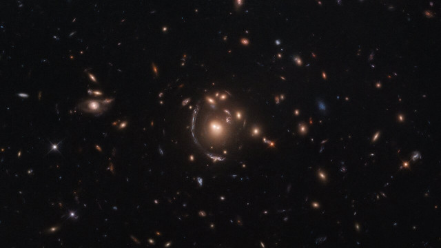 Hubble Spies Galaxy through Cosmic Lens